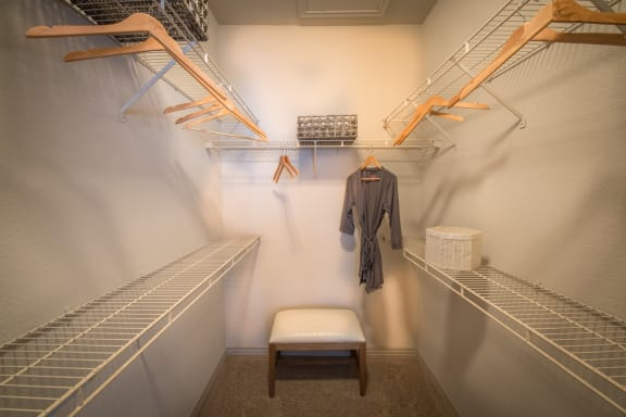 This is a photo of the walk-in closet in th 826 square foot 1 bedroom  apartment at The Brownstones Townhome Apartments in Dallas, TX.