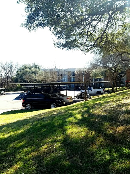 This is a photo of the covered parking in the parking lot at Cambridge Court Apartments in Dallas, TX