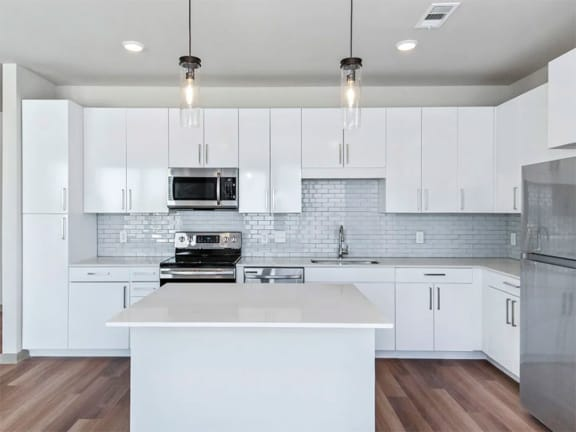 Chef Inspired Kitchen Islands with Designer Lighting at Pier 33 Apartments, Wilmington, 28401