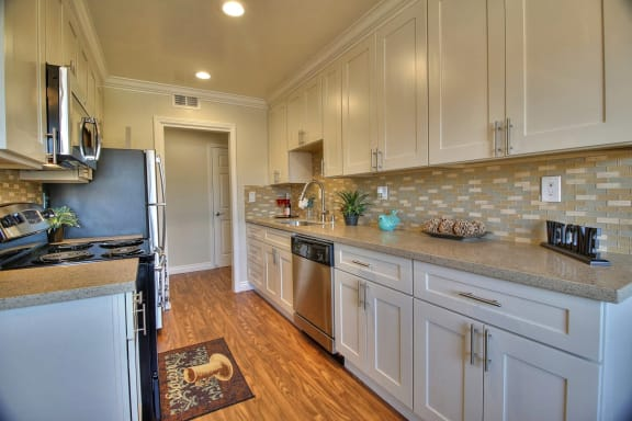 modern kitchen with stainless steel appliances  at Californian, Mountain View, CA, 94040