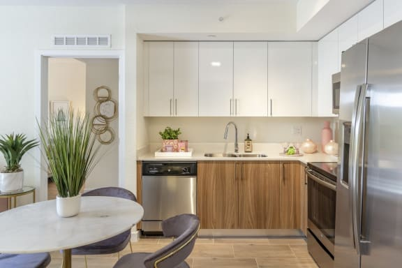 Custom dual-toned cabinetry at Alameda West, Miami, FL, 33144