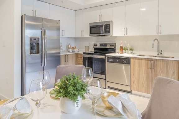 Well Equipped Kitchen And Dining at Twenty2 West, West Miami, FL