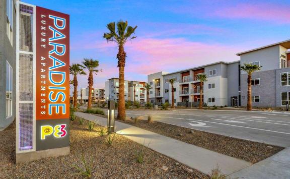 Property Signage with Palm Trees at Paradise @ P83 Apartments, Peoria, Arizona