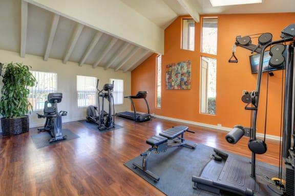 Fitness Center with Elliptical, Excercise Bike, Treadmill, Windows and Hardwood Inspired Floors