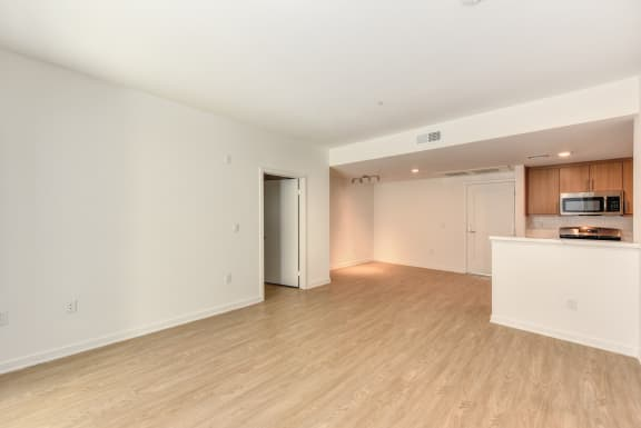 Vacant home with white painted walls and hardwood inspired flooring through out the home.