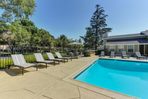 Pinecrest swimming pool area with lounge seating along the pool deck