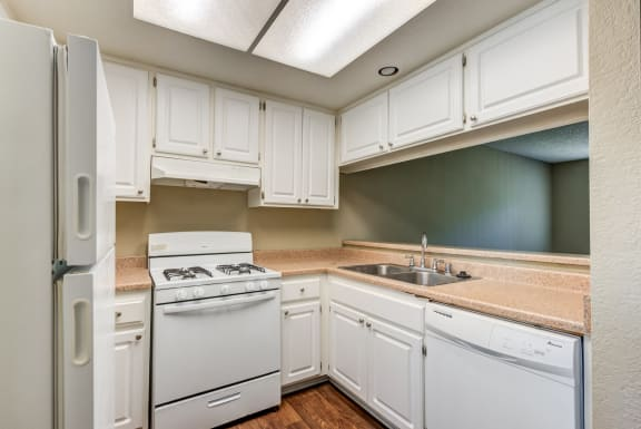 Timeless Kitchens featuring white cabinets and appliances.