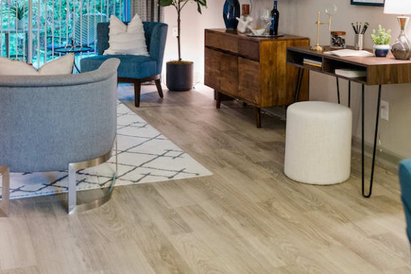 living room with hardwood-inspired flooring at The Jameson Apartments, Alabama