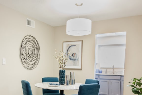 dining area with upgraded lighting and model dining set at The Jameson Apartments, Alabama, 35209