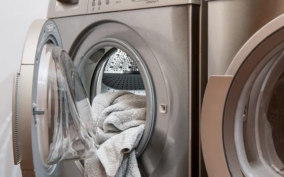 towels in a dryer beside washer at The Jameson Apartments, Alabama, 35209
