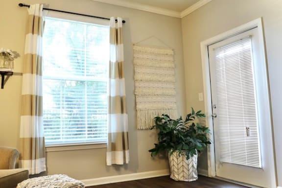 living room window and patio door with venetian blinds