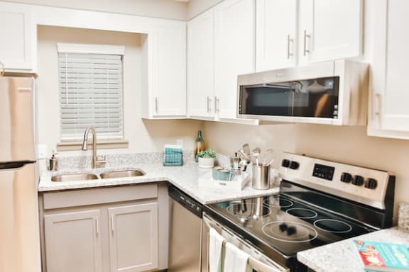 kitchen with ample cabinetry, stainless steel appliances, and granite countertops at Berry Falls Apartments, Vestavia Hills