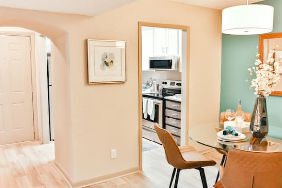 arched entrance into dining room with model furnishings at Berry Falls Apartments, Vestavia Hills, AL
