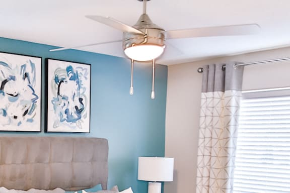 modern ceiling fan in bedroom with accent wall at Berry Falls Apartments, Vestavia Hills, 35216