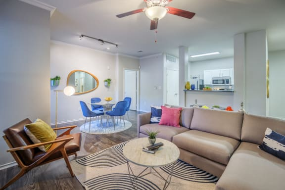 Modern Living Room With Kitchen View at Elan Apartment Homes, Texas