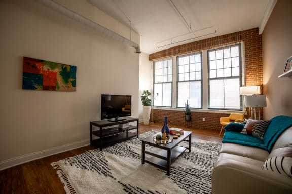 Living Room With TV at Harness Factory Lofts, Managed by Buckingham Urban Living, Indiana, 46204