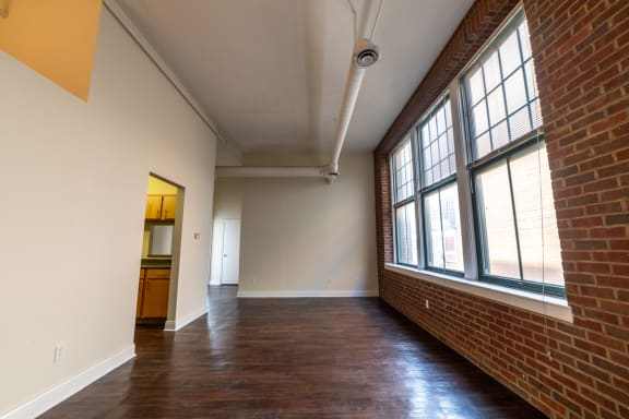 Wood Inspired Plank Flooring at Harness Factory Lofts, Managed by Buckingham Urban Living, Indianapolis, 46204