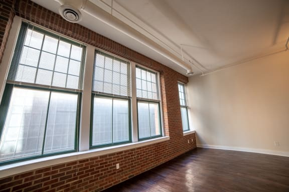 Floor To Ceiling Windows at Harness Factory Lofts, Managed by Buckingham Urban Living, Indiana, 46204