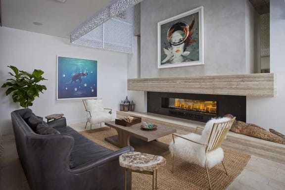 Seating by clubhouse fireplace l Apartments for rent in Coronado CA
