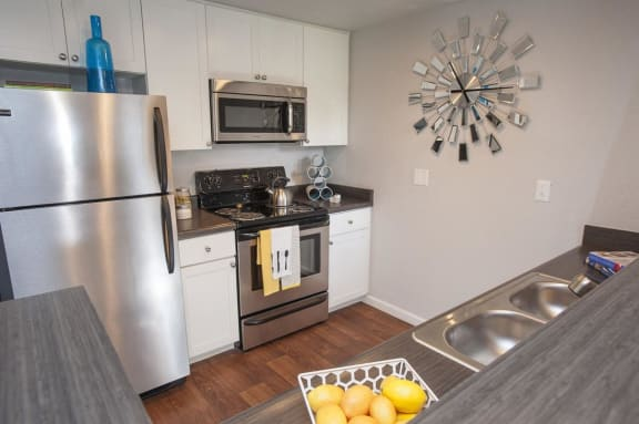 Kitchen with stainless steel appliances  l The Edge Apartments in Davis, CA