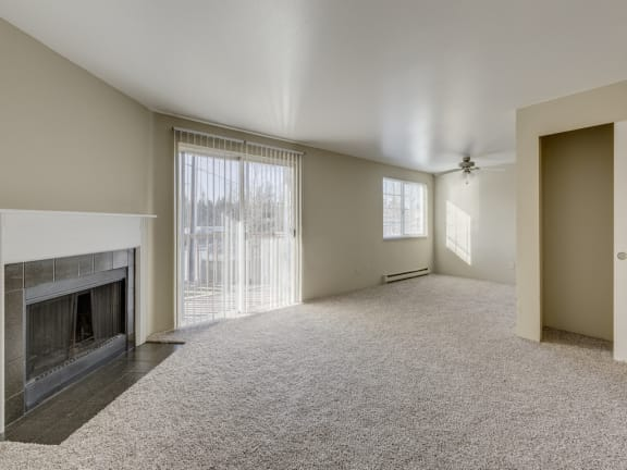 Large Living Room With Fireplace and Over sized Windows at Mirabella Apartments, 805 112th St SE, Everett, Washington