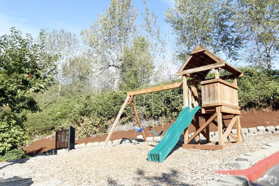 outdoors playground with slide and swings at Copper Creek in Milton WA