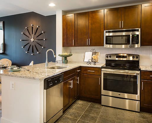Stainless steel Energy Star appliances at Aurora Apartments, North Bethesda, MN