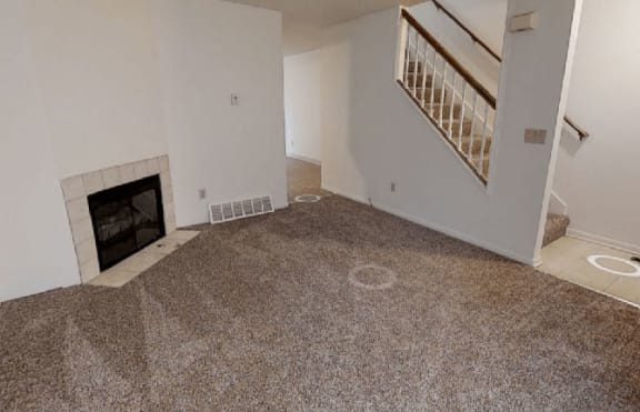 Living Room with Fireplace at Arbor Pointe Townhomes, Michigan