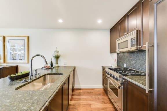 Kitchen with Granite Countertops and Espresso Cabinetry at The Bravern, 688 110th Ave NE, Bellevue