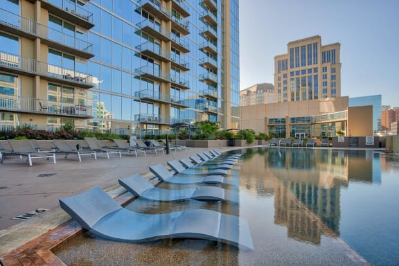 4th Floor Amenity Deck with Infinity Edge Pool, Private Cabanas and Putting Green at Glass House by Windsor, 75201, TX