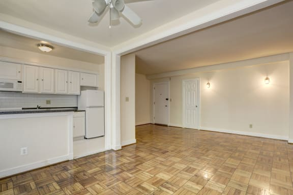 room with ceiling fan at wood floors  at Tivoli Gardens Apartments in Washington, DC