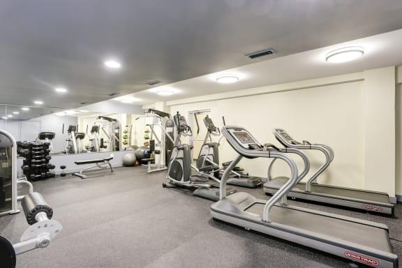 fitness center with cardio machines  at Tivoli Gardens Apartments in Washington, DC