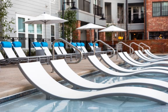 Poolside Relaxing Area at Santos Flats Apartment Homes, Tampa, Florida