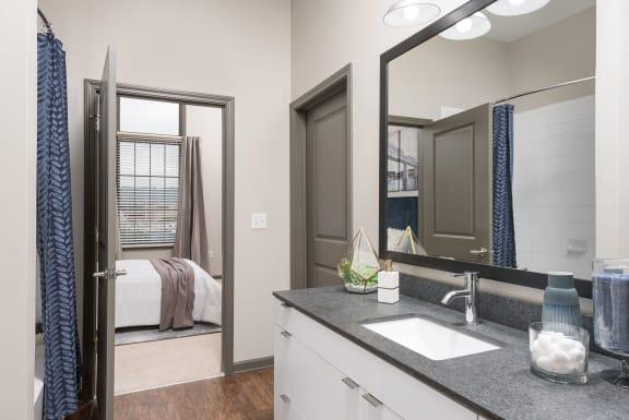 Renovated Bathrooms With Quartz Counters at Santos Flats Apartment Homes, Tampa, 33619