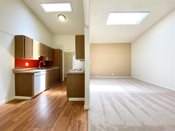 Wood-Style Flooring in Kitchen at Valley West Apartments in San Jose, CA 95122