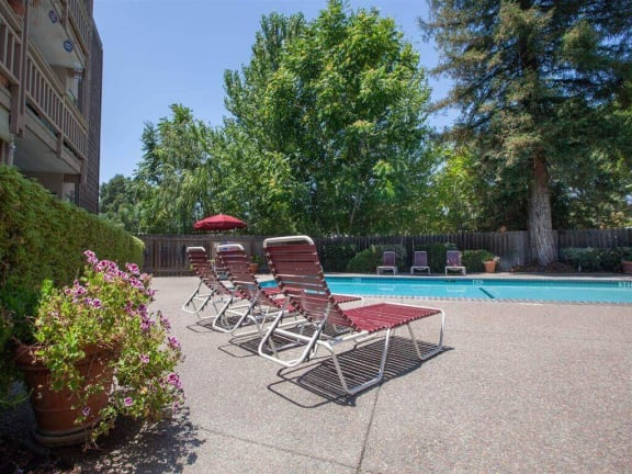 Pool Side Relaxing Area With Sundeck at The Glens, California