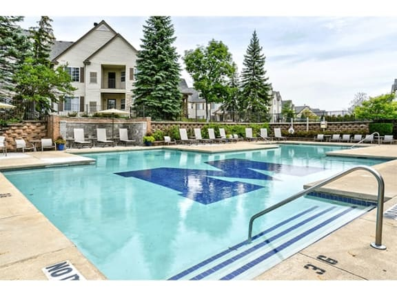 outdoor pool with sundeck at The Villas at Main Street Apartments in Ann Arbor, MI