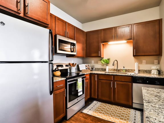 Modular kitchen with essentials at Residences at The Streets of St. Charles, Missouri, 63303