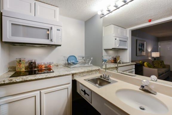 studio kitchen from bathroom at Plato's Cave Apartments Branson, MO 65616
