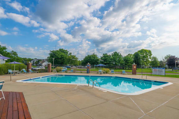 Refreshing Pool With Large Sundeck at Arbor Lakes Apartments in Elkhart, IN
