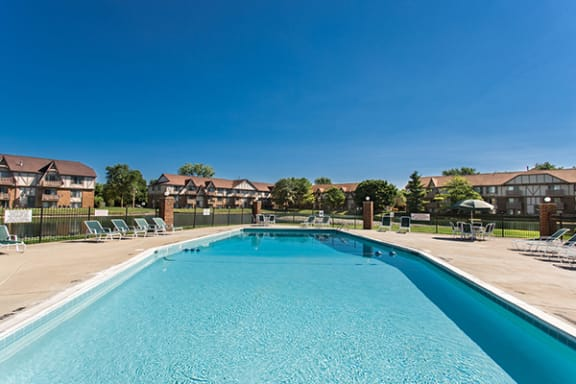Lakeside Outdoor Swimming Pool with Spacious Sundeck at Bavarian Village Apartments, Indiana