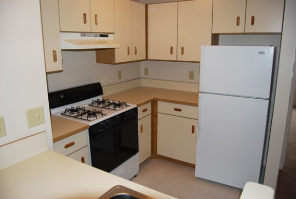 Two Bedroom Kitchen at Heatherwood Apartments in Grand Blanc, Michigan