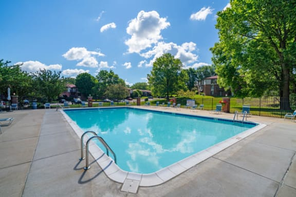 Pool with Large Sundeck at Old Farm Apartments in Elkhart, IN