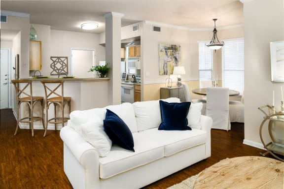 living room with Pass Through Kitchen Bars