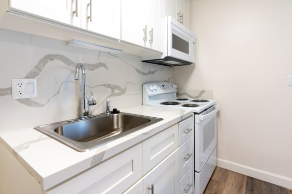 quartz countertop with kitchen sink and stove