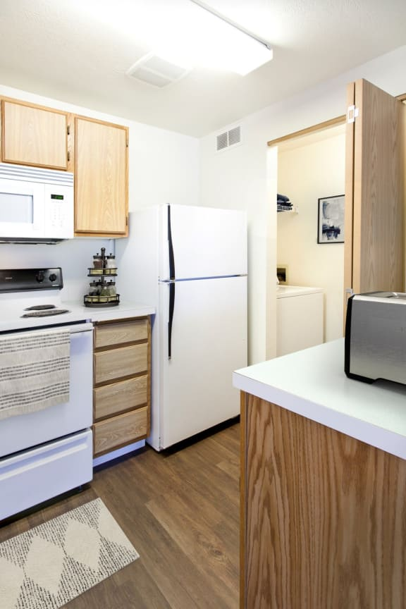GoGo West Apartments 2 Bed Floor Plan Kitchen and Laundry Closet