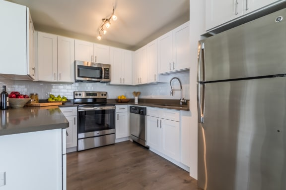 A spacious kitchen with stainless steel appliances at The Harbor.