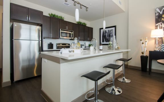 Kitchen with black interior at The Kelley, Texas, 76102