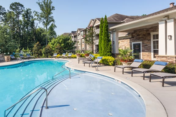 The Oaks at Johns Creek resort-style pool and surrounding sundeck