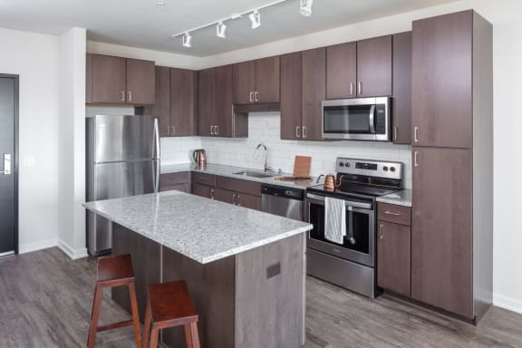 New Apartments Rochester MN near Mayo Clinic with New Kitchens with Prep Island, Custom Cabinetry, Backsplash & Stainless Appliances-The Maven on Broadway